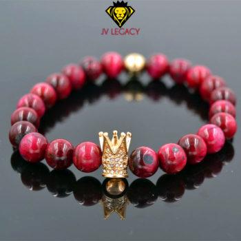 Pulsera unisex de corona hecha de piedra natural con detalle en forma de corona.